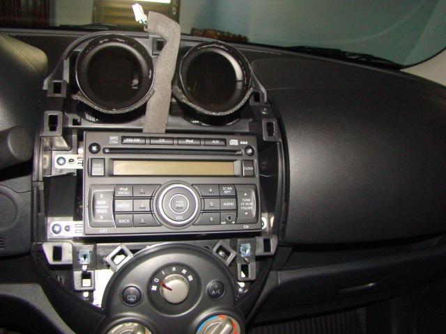 Painel desmontado com rádio original